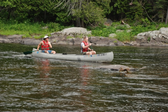 Kenzan and Paul in Rapids in Grumman Canoe