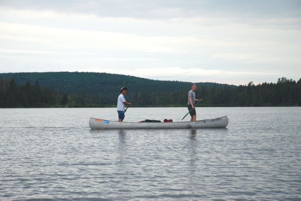 Paul and Kenzan Standing in Grumman Canoe