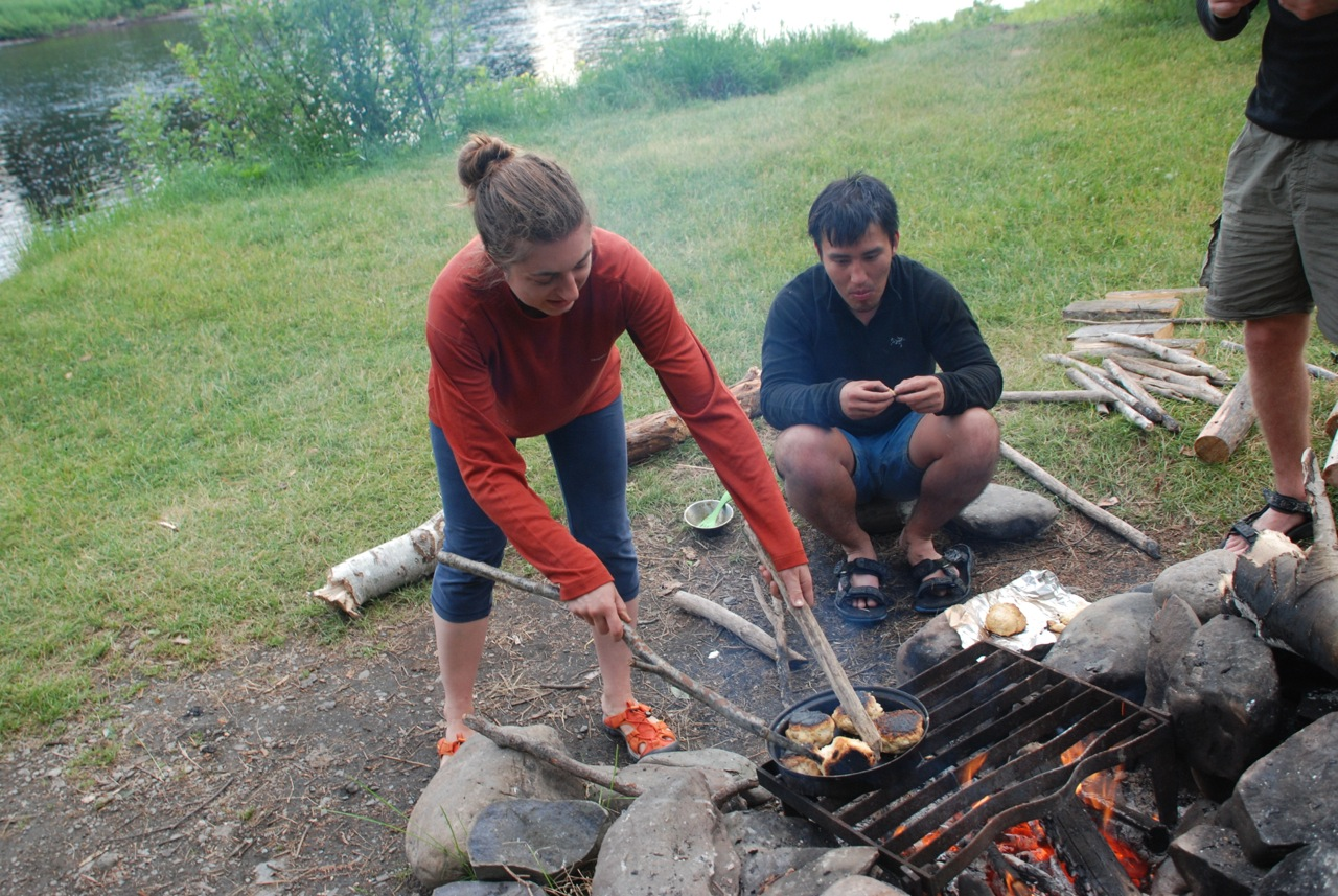Spenser Cooking Biscuits Over A Campfire