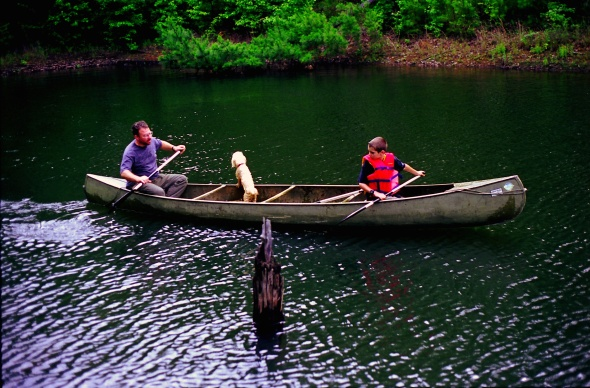 My father and I in my grandfather's canoe back in 1999.